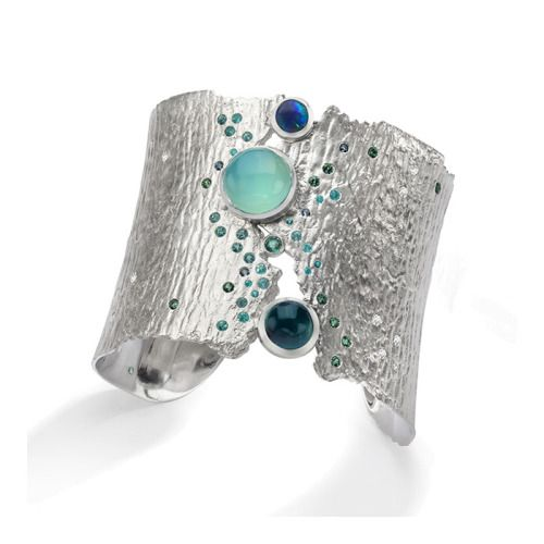 Oceania Cuff , sterling silver, blue tourmaline, blue green opal, emerald and gem silica, flush set parabia tourmaline, aquamarine, green sapphires and white diamonds