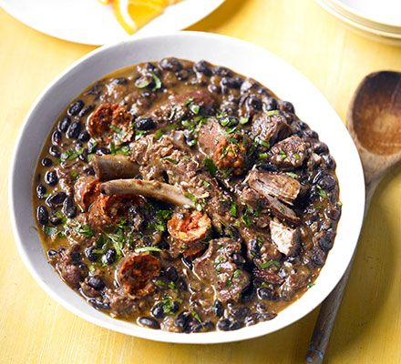 Black bean & meat stew - feijoada. Chorizo, pork ribs and pork shoulder make the base for this hearty Brazilian casserole with deeply savoury spiced pulses