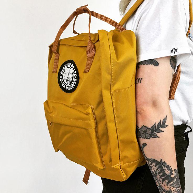 Zoe rocking the Mustard Backpack.