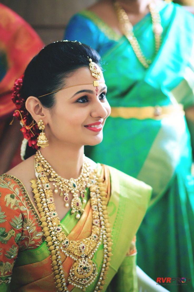 South Indian bride. Gold Indian bridal jewelry.Temple jewelry. Jhumkis. Green silk kanchipuram sari.Braid with fresh jasmine flowers. Tamil bride. Telugu bride. Kannada bride. Hindu bride. Malayalee bride.Kerala bride.South Indian wedding.