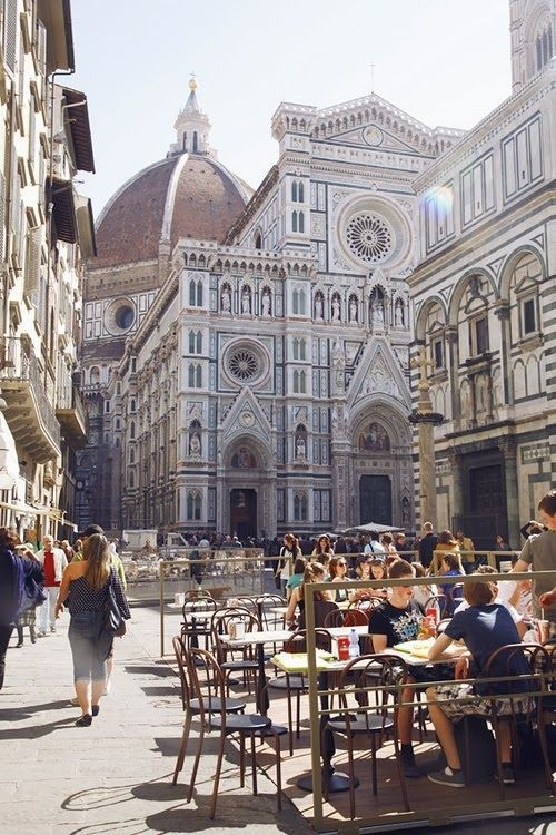 busy street with a view of the Duomo in Florence, Italy. There's a gelato shop here with cones as big as your head!
