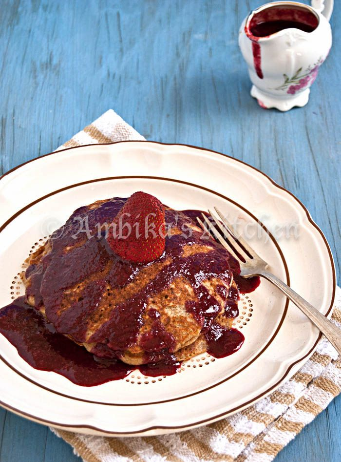 Gluten free banana oatmeal pancakes with an easy homemade berry syrup. Absolutely delicious!!