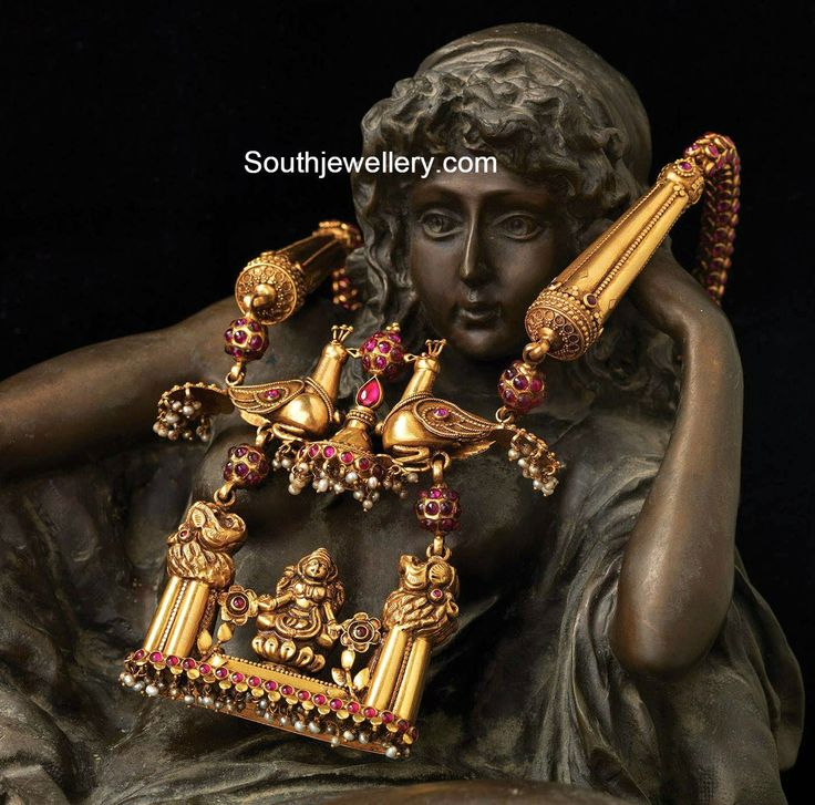 antique gold necklace with peacock and lakshmi pendant