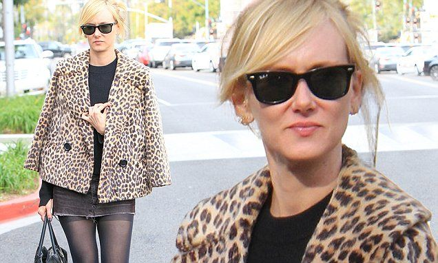 Kimberly Stewart dons leopard spot jacket and sexy black mini to shop