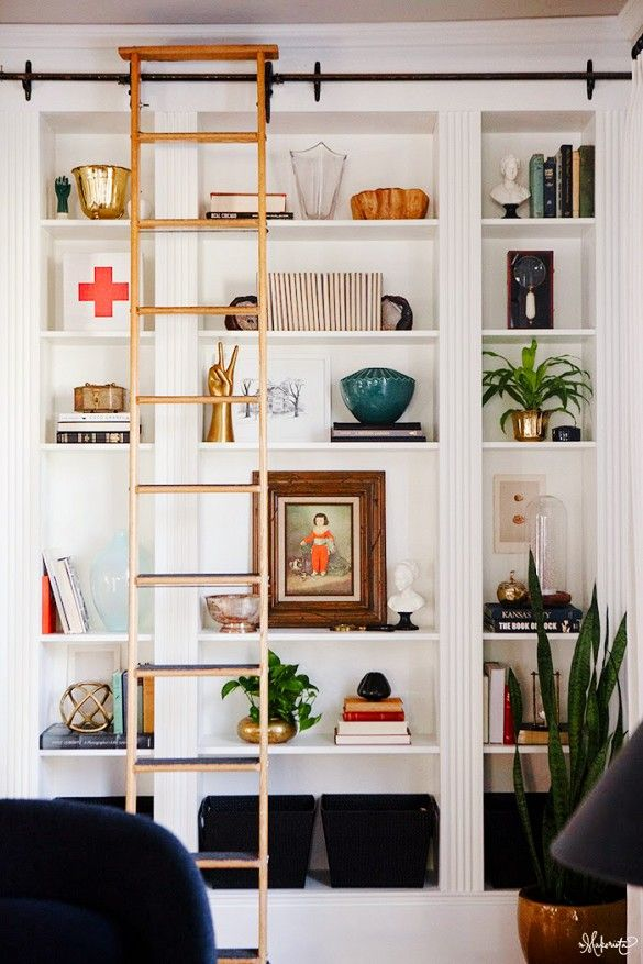 A Built-In Ikea Billy Bookcase- use baseboard and crown molding to make it blend into the wall