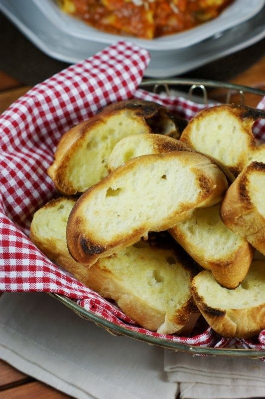 Classic Garlic Bread ~ easy, thick-cut garlic bread that is crunchy on the outside, soft and chewy on the inside, and oh so delicious!  www.thekitchenismyplayground.com