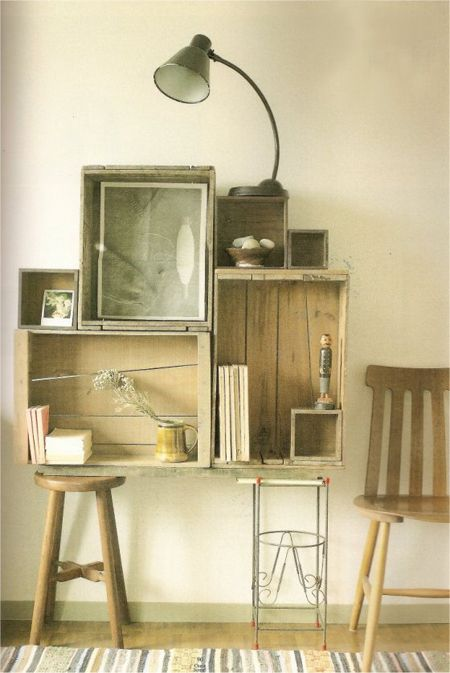 Old wooden boxes in a design on the wall...nice way to add shelving and texture.