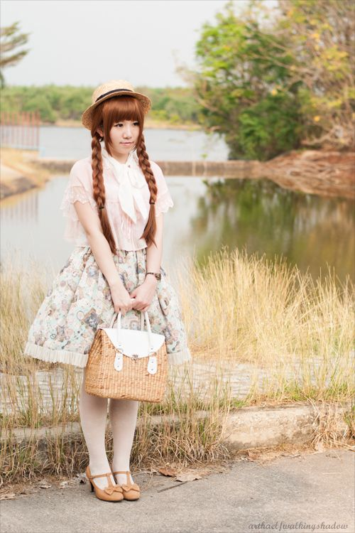 Country Lolita, I think, with that straw hat and the braids. Rather Anne of Green Gables, Japanese style.