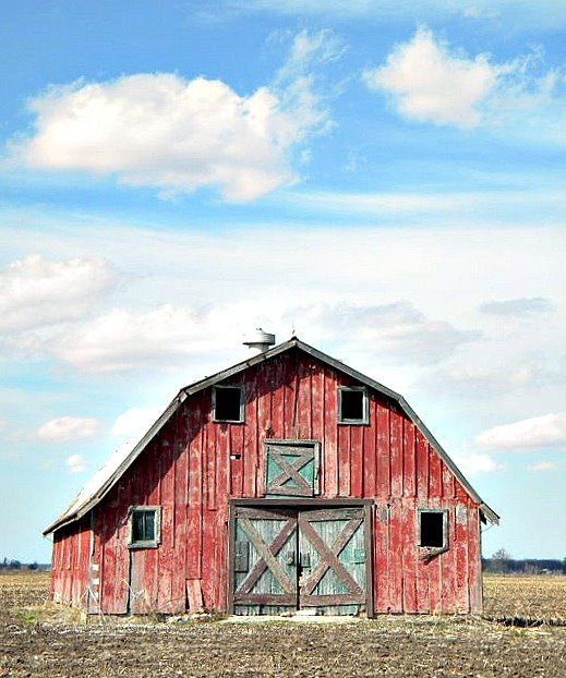 a beautiful classic old red barn...