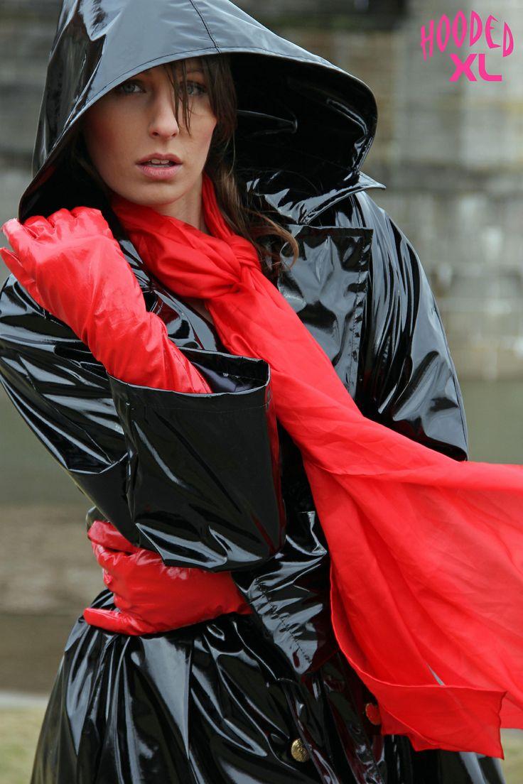 shiny black vinyl raincoat red gloves