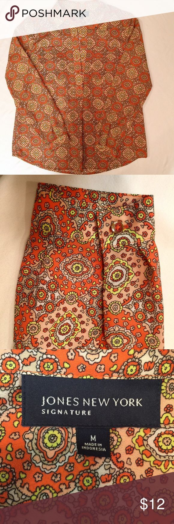 Jones NY orange print blouse Really striking print with orange and touches of blush and lime green. 2 breast pockets. Pleat under the front button placard, and pleat in back. Easy care machine wash/drip dry.  $9 from this sale will be donated to local homeless shelters. Jones New York Tops Blouses