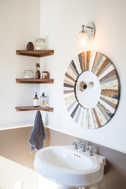 We didnt want our bathroom to feel cluttered, so we opted for a pedestal sink with corner shelves.