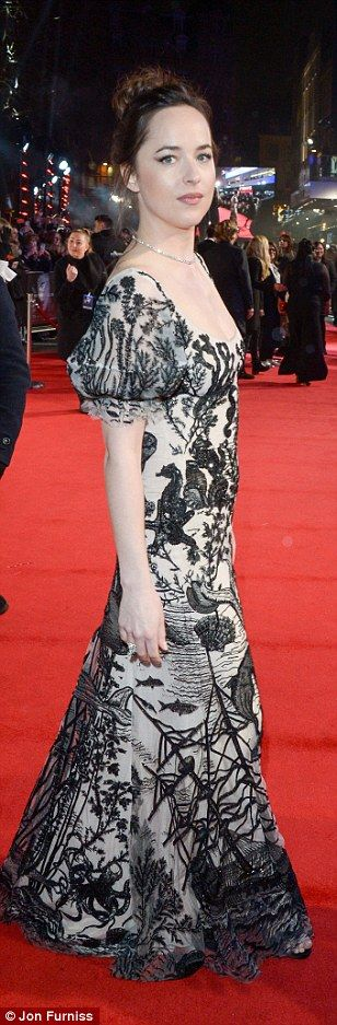 Monochrome beauty: Dakota stunned in a classic gown with aquatic embroidered detailing