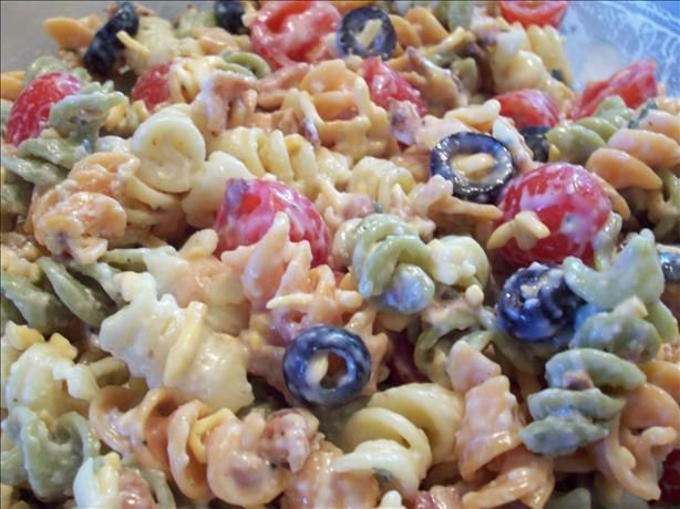 ranch pasta salad with bacon...instead of olives and tomatoes add peas.