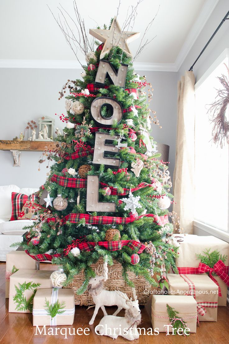 This tree couldn't be more festive with springs of snow-dusted pinecones, twine ornaments, marquee letters, plaid, woodland creatures, and much more. Get the tutorial at Craftaholics Anonymous.