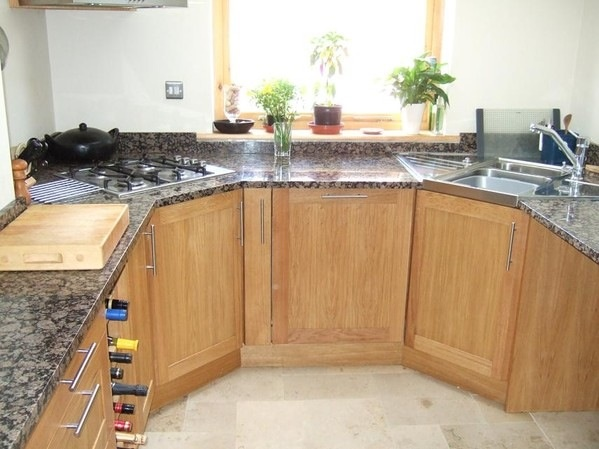 Full Hob Kitchen ~ Corner hob idea but round off a wooden worktop around the