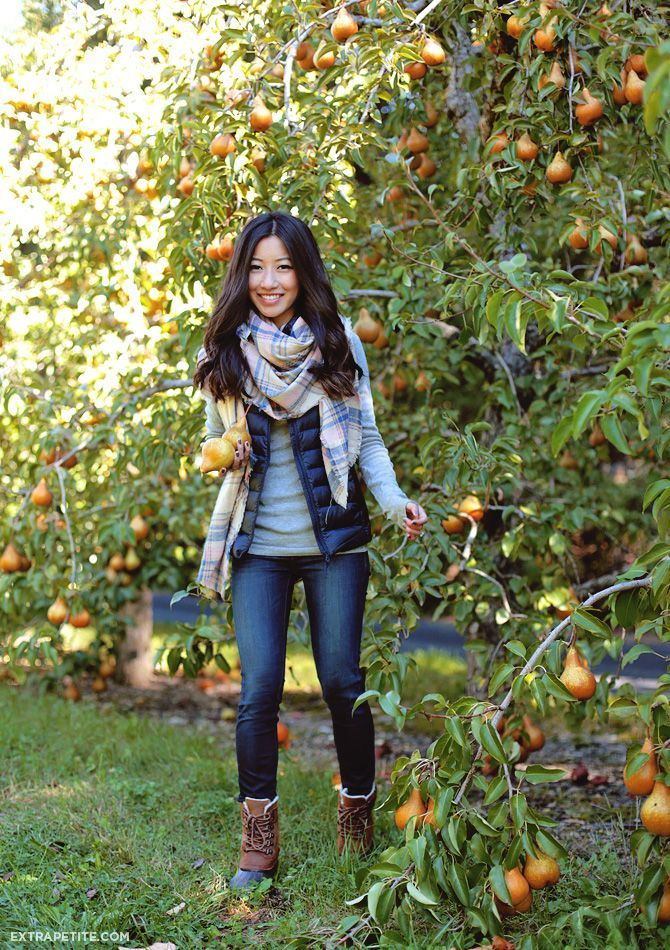 Casual preppy outfit idea in puffer vest + plaid scarf + skinny jeans + sorel boots
