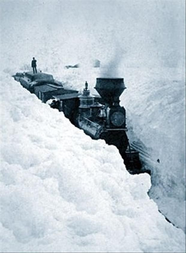 Must have been slow going. See the man standing on top of the train? Wonder who was doing the shoveling.