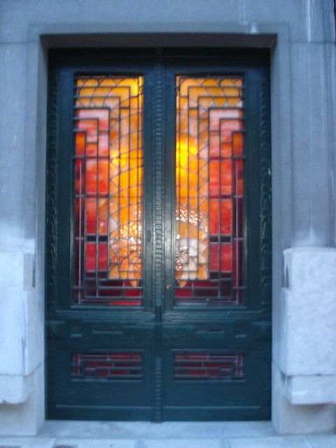 Stained glass panels set in a blue painted door in Brussels.
