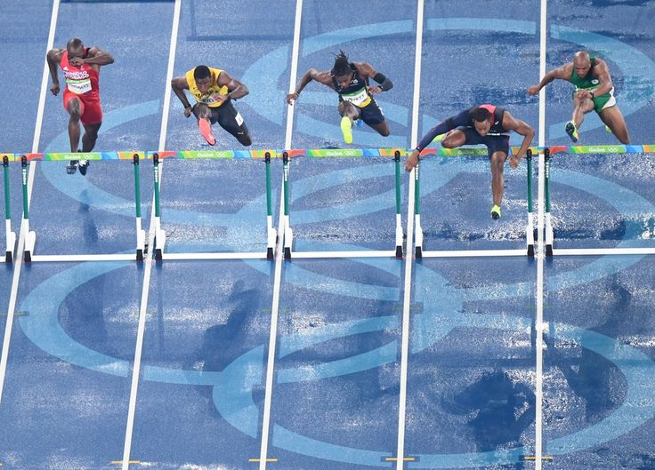 (LtoR) Trinidad and Tobago's Mikel Thomas, Jamaica's Andrew Riley, Virgin Islands's Eddie Lovett, France's Dimitri Bascou and South Africa's Antonio Alkana compete in the Men's 110m Hurdles Round 1 during the athletics event at the Rio 2016 Olympic Games at the Olympic Stadium in Rio de Janeiro on August 15, 2016.   / AFP / Antonin THUILLIER