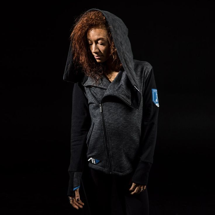 For those cold days leading your fireteam of military-trained explorers to new uncharted planets. We want you to look your best when you lead the Arks to our new home.  260 gram, 55% fleece 45% polyester zip hoody Cross-body metal zipper closure with custom Andromeda zipper pull Ribbed bottom and cuffs for snug gif Embroidered Pathfinder patch on left sleeve Contrasting blue thumbholes Rubber Andromeda logo patch on right hip BioWare woven label on hood Oversized hood that turns int...