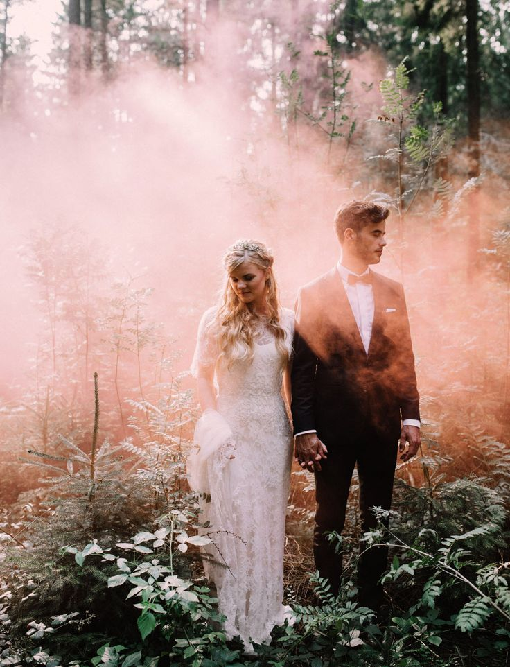 Pink smoke bomb wedding portrait