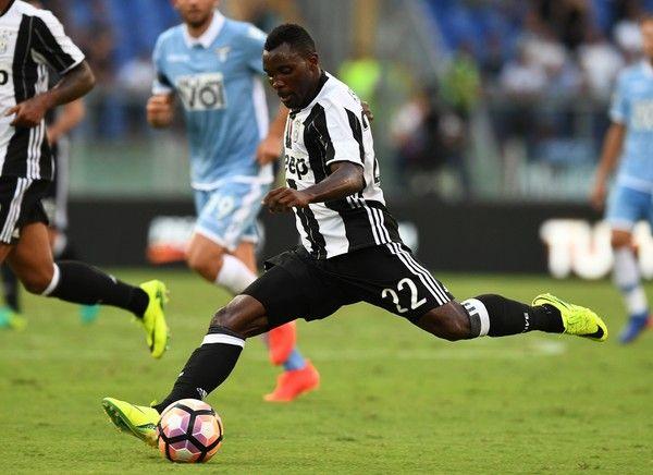 Juventus' Ghanaian midfielder Kwadwo Asamoah kicks the ball during the Serie A…