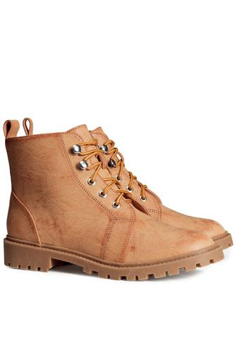 """Ankle boots in imitation leather with laces and chunky rubber soles."" H&M Boots, $39.95, available at H&M."