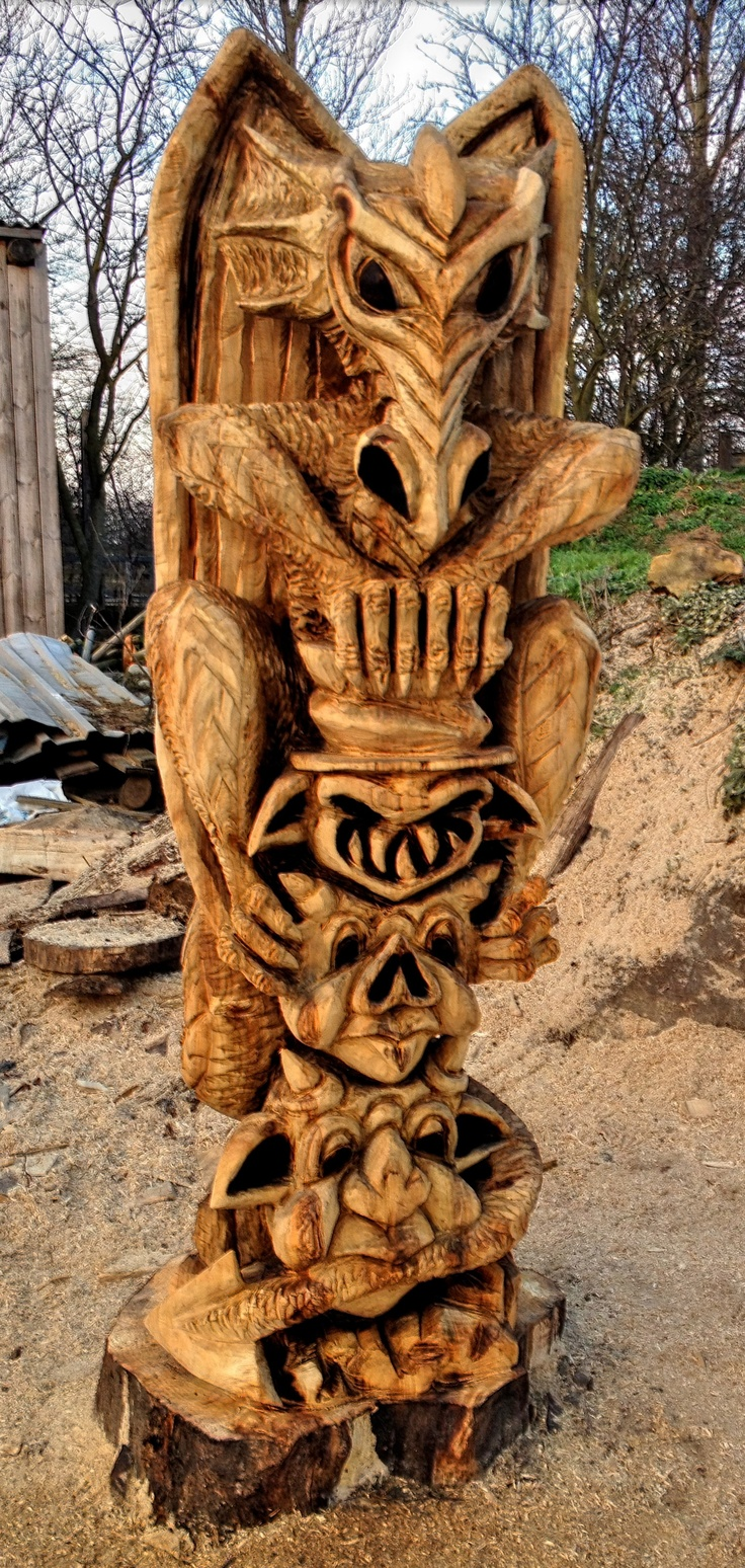 Dragon and gargoyle totem pole carved completely with