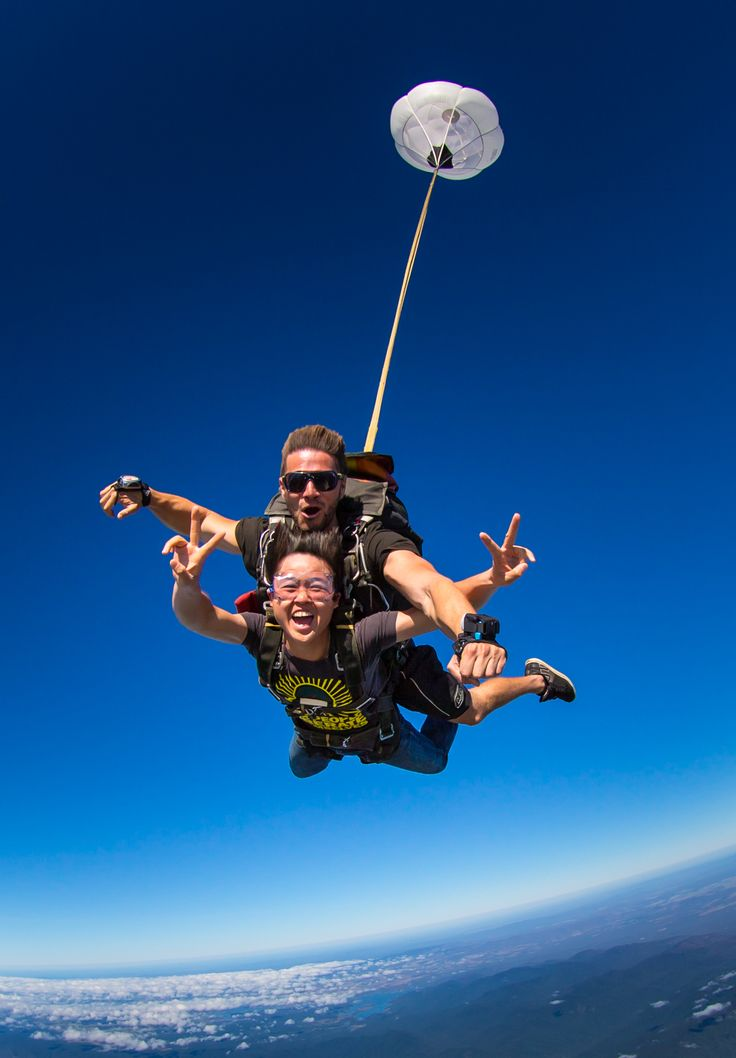 Peace out! Make like this tandem skydiver and get amongst the clouds with one of our highly qualified skydiving instructors. #SkydiveAustralia #skydive #bucketlist #adrenaline #tandemskydiving