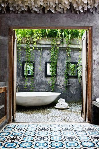 Concrete and timber, a dramatic pop of pattern, pebbles and plants cascading down the walls. Beautiful outdoor bathroom!!