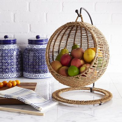 Healthy eating is in full swing. With an iron frame and hand-woven seagrass basket, our Fruitasan offers a pretty perch for your fruits.