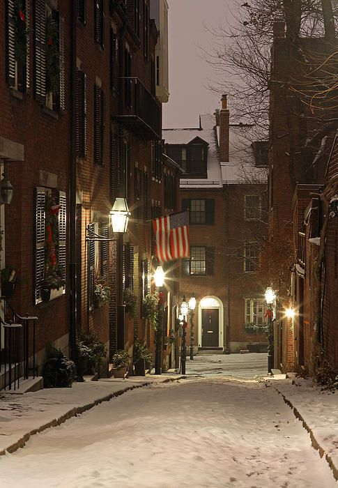 Romantic Boston cityscape photography of old colonial brick row houses along Acorn Street on a beautiful, chilly winter evening. The first snow of the 2013/20114 season covers the cobble stone street on Acorn Street near Louisburg Square, the most prestigious address in Beacon Hill. My best, Juergen   Art Prints: www.RothGalleries.com  Digital: http://juergenroth.photoshelter.com  Facebook: https://www.facebook.com/naturefineart  Twitter: @NatureFineArt