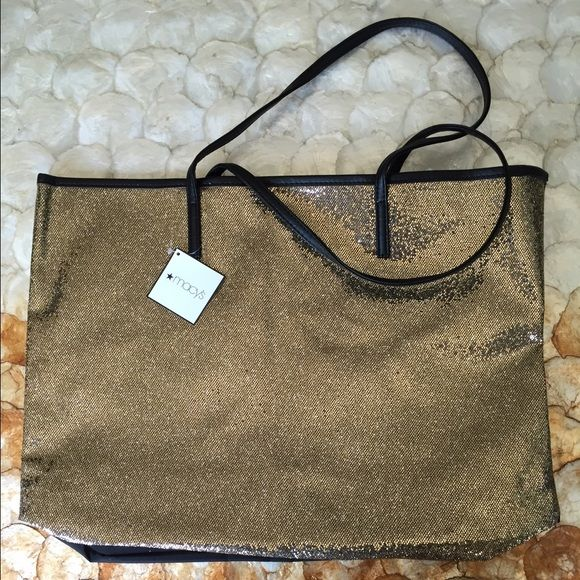 """NWT Glittery gold tote bag! Gorgeous bag from Macy's! Glittery gold on one side and solid black on the other.. Magnetic closure.. NWT! Dimensions: approx 17""""x12.5"""" Macy's Bags Totes"""