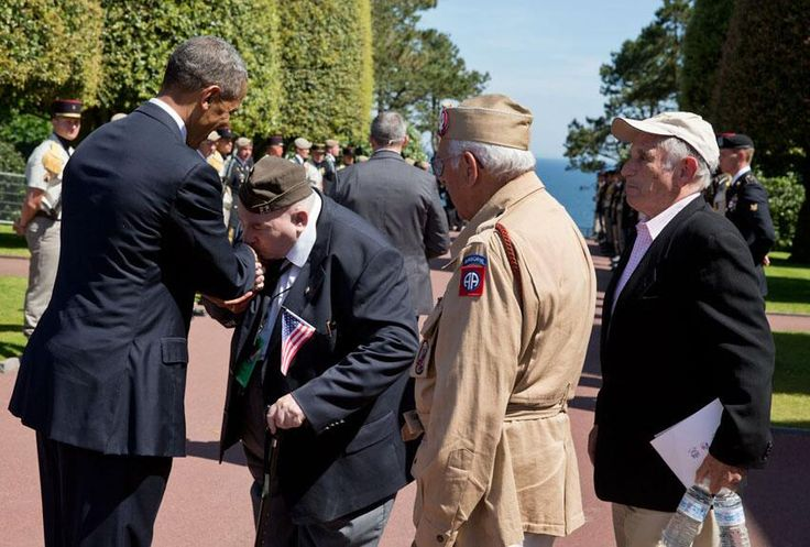 A WW2 veteran greets President Obama with a kiss at Normandy