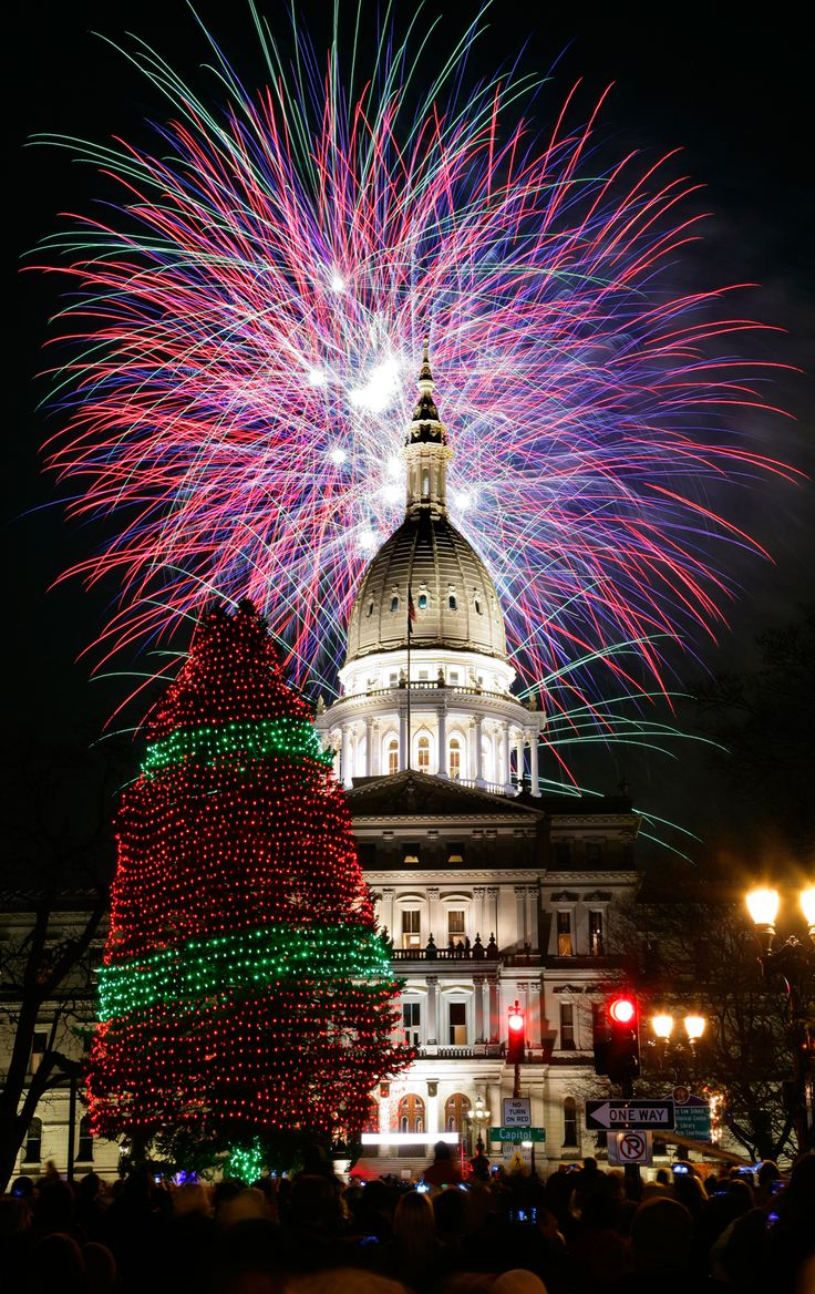 Fireworks explode over the state Capitol following the lighting of the state Christmas tree on November 16, 2012, in Lansing, Mich. (Al Goldis/Associated Press)