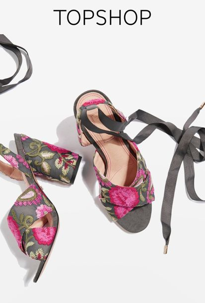 Add a feminine feel to your going-out look in the unique REENA sandals in floral embroidery.