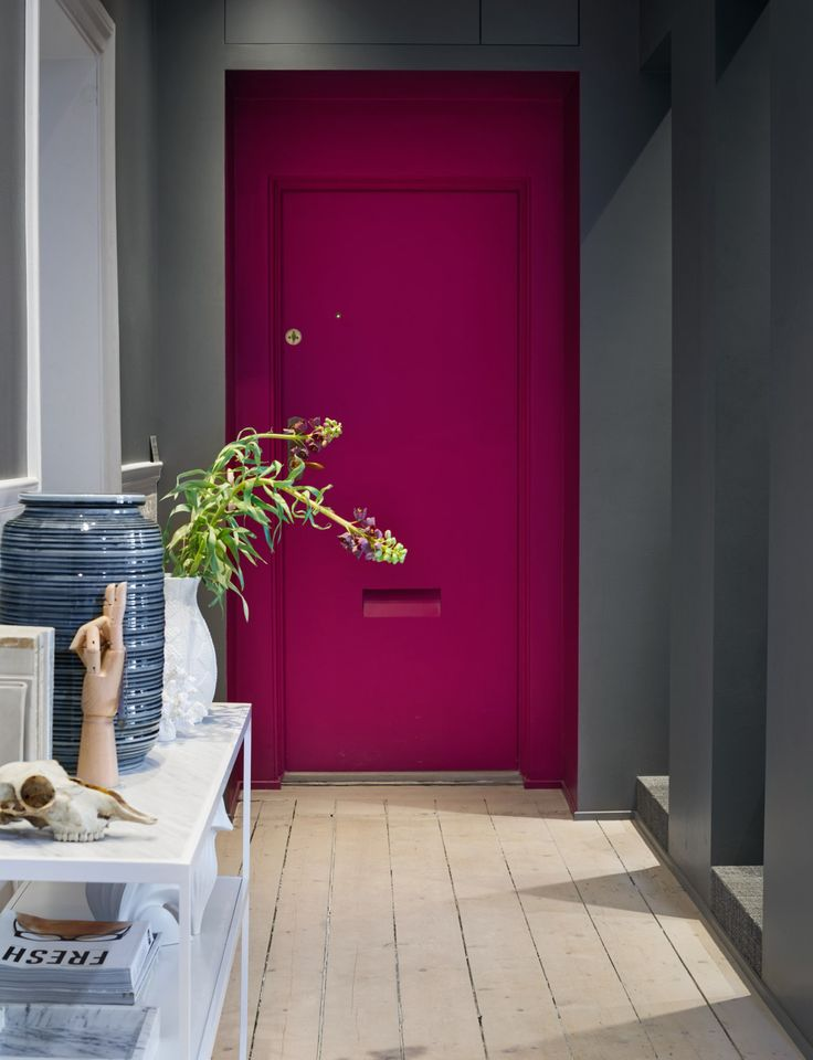 Dark coloured home with a bright pink door via Sköna Hem gravityhomeblog.com - instagram - pinterest - bloglovin