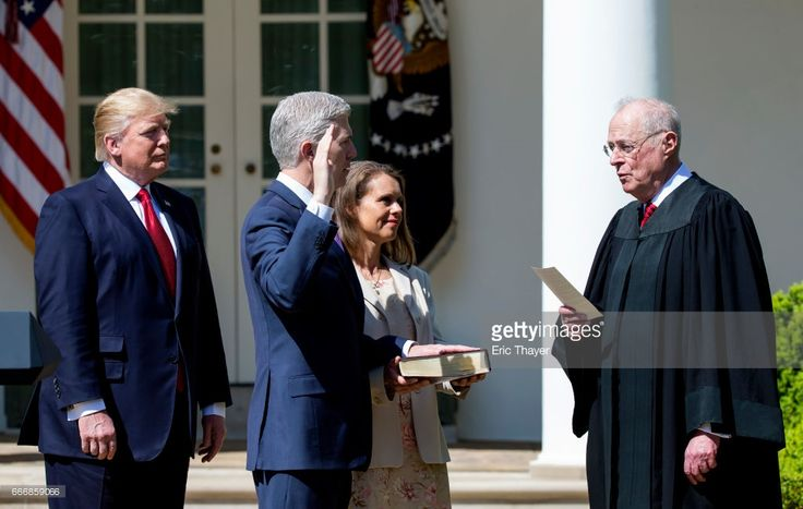 U.S. Supreme Court Associate Justice Anthony Kennedy administers the judicial oath to Judge Neil Gorsuch as President Donald Trump looks on during a ceremony in the Rose Garden at the White House April 10, 2017 in Washington, DC. Earlier in the day Gorsuch, 49, was sworn in as the 113th Associate Justice in a private ceremony at the Supreme Court.