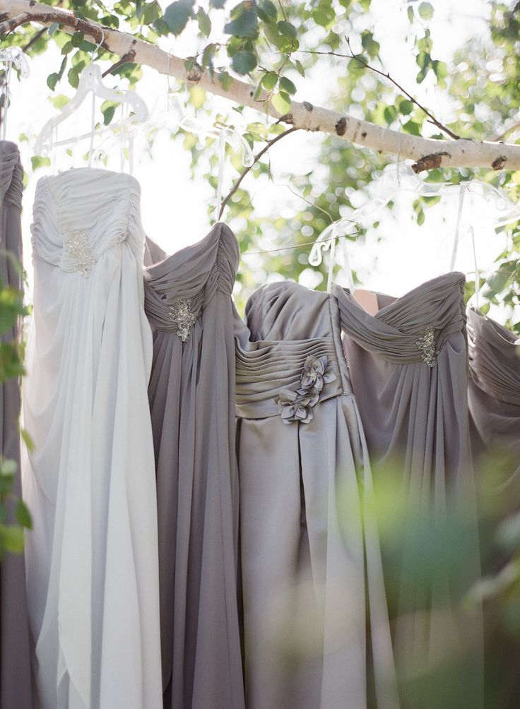 #Bridesmaids Dresses -- Shades of Gray || More on Style Me Pretty: http://www.StyleMePretty.com/2014/02/12/diy-greenwood-hills-country-club-wedding/ The McCartneys Photography