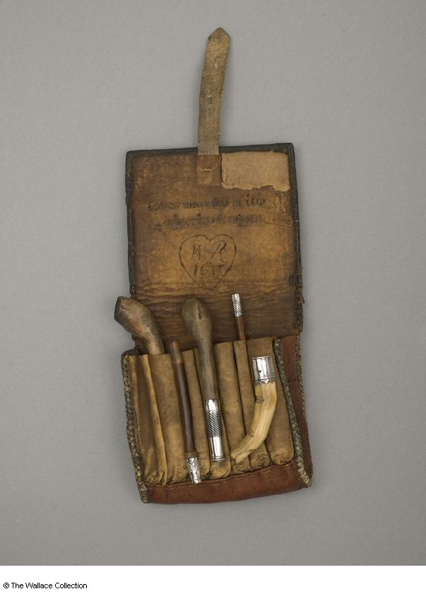 This pipe pouch with clay pipes and tobacco stopper from the Wallace Collection in London is believed to have been Sir Walter Raleigh's own. It was found in his cell after his execution 29 October 1618 for treason under the rule of King James I.