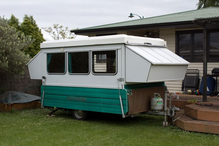 Trying out the caravan in the back yard just after we purchased it. Folds down to a trailer, but has hard sides. Sleeps an amazing 5 people very comfortably!