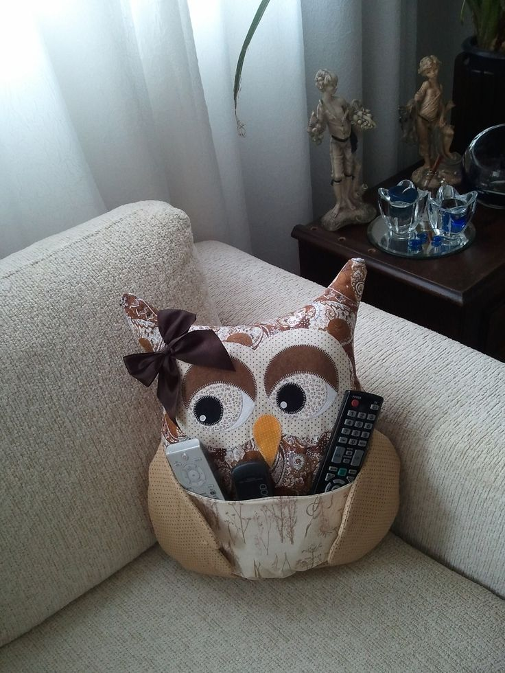 I like the idea of an owl throw pillow with pockets for the remotes but not so cartoonish and with pockets on the back. Not distract from the owl look that way.