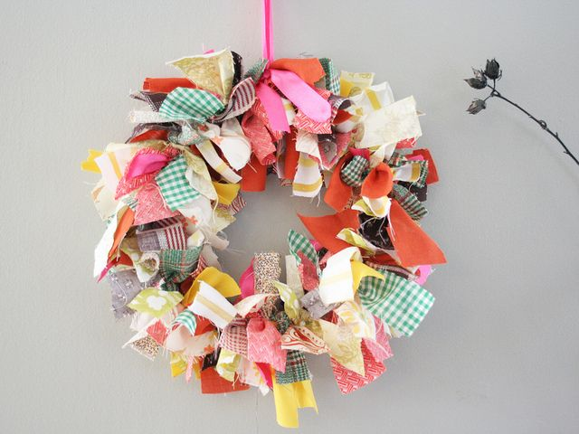 "fabric scraps wreath. Need to do with my scraps.  I actually received a Christmas scrap one this year..I have another one hanging in my kitchen that has my ""green"" colors in it..hung it on a door with fish line!"