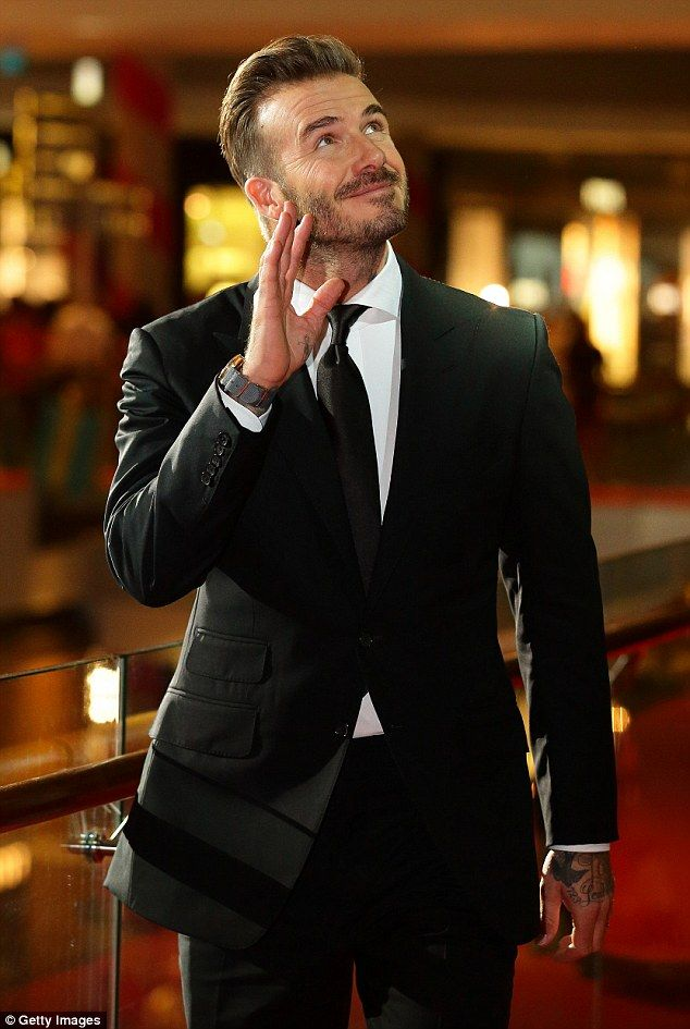 Crowd-pleaser:The 40-year-old football ace looked effortlessly dashing in a suave black s...