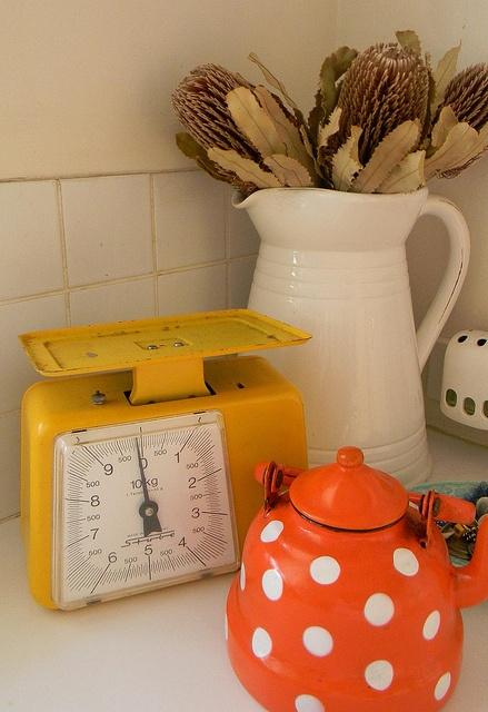 Retro yellow Stube kitchen scales with polka dot teapo