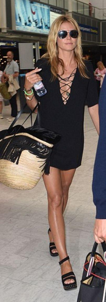 Who made Heidi Klum's straw fringe handbag, sunglasses, and black platform sandals?