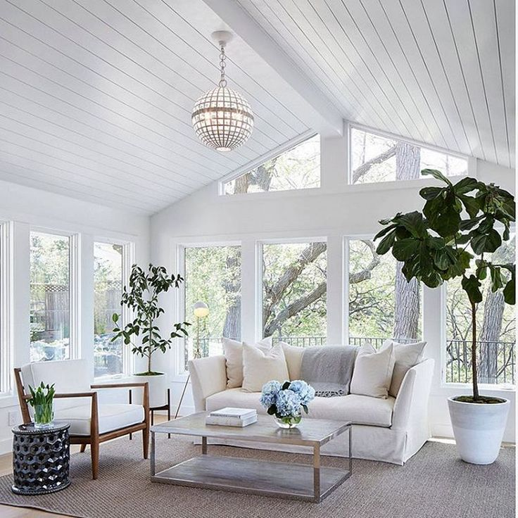 This family room/sunroom is pure serenity with its white walls and tongueandgroove ceiling. Paintcolor is #BenjaminMoore SuperWhite. #homebunch #sunroomandconservatory