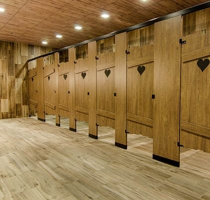 outhouse custom toilet partitions by ironwood manufacturing laminated slat construction with engraved hearts floor
