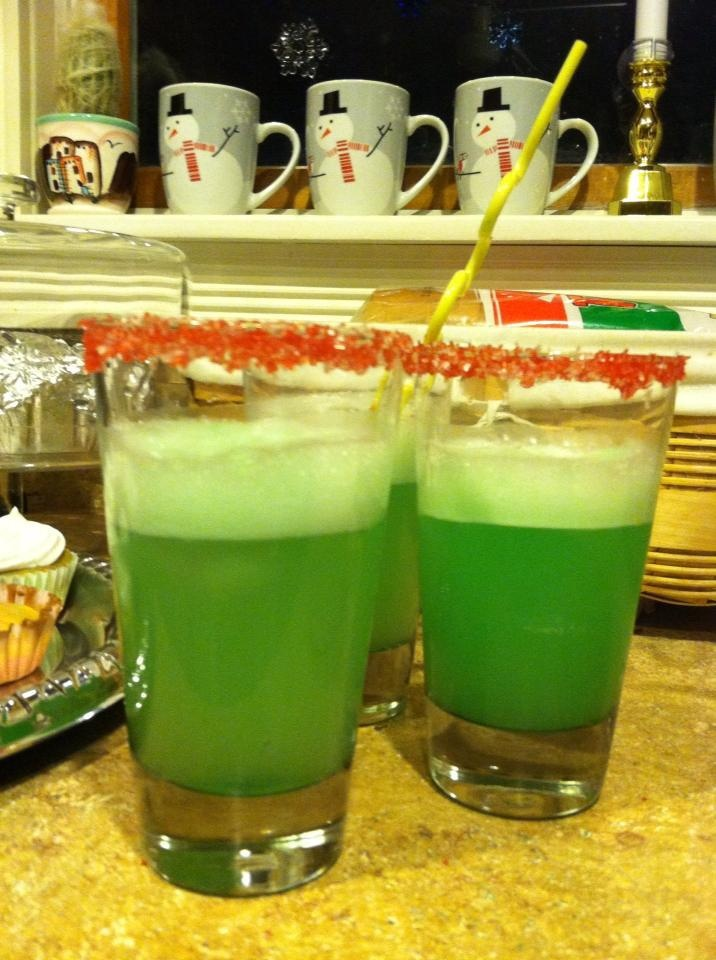 Grinch Punch for a Whobilation: Wet the rim of the glass with water and dip into colored sugar (green would be better) then scoop lime sherbet into a glass, add Sprite and a few drops of food coloring. We added a crazy straw for a more Who-y look! #Grinch #Grinchparty #GrinchPunch